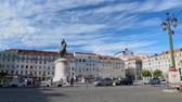 lisboa : Tourists walking around Square of Fig Tree, looking at statue of King John