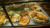 guloseima : Wide range of seafood lying on showcase of little restaurant, sea cuisine Stock Footage