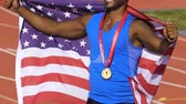 muhterem : Athlete proudly showing flag of his country and honorable gold medal on chest