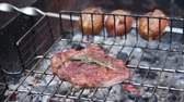 cena urbana : Fresh meat and potatoes grilling on fire, delicious food in fresh air, close-up