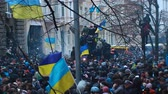 berkut : Hundreds of Ukrainians with national symbolics during Hrushevsky Street clashes Stock Footage