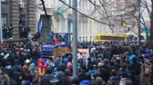 berkut : Big blue and yellow bulldozer moving backwards in middle of Ukrainian protesters