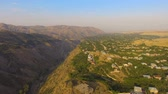 green canyon : Wonderful aerial view of mountain valley and old Armenian village on sunny day Stock Footage