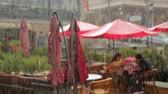 таверна : Couple having lunch on cafe terrace, romantic date under rain, relationship
