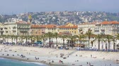 Summer holidays in Nice, people sunbathing on the beach, sunny resort city
