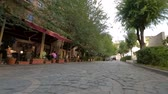 open air museum : Open air restaurant near Big Cascade in Yerevan, people walking beside monument