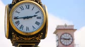 kifinomult : Retro style clocks decorating old park and central city square, measuring time Stock mozgókép