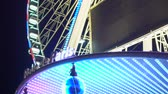 gigantesco : Roue de Paris French sign with changing lights at gleaming Big Wheel entrance Vídeos