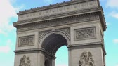 triumphal arch : National French symbol Arc de Triomphe against blue sky background.