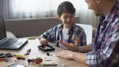 отвертка : Father and son repairing small household appliances, support and reliance Стоковые видеозаписи