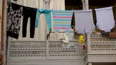 varal : Cloth drying on balconies, poor areas of the city, quiet district, homework.