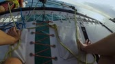 napnout : Person sailing on windsurfing catamaran on tied up together by ropes trampoline