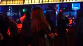 desatualizado : Attractive young lady dancing at night club, man in suit approaching her, disco