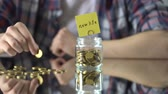 gider : New life phrase written above glass jar with money, crucial moment concept