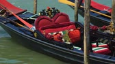 припаркован : Decorated with romantic seats gondola swaying on water, trip for newlyweds