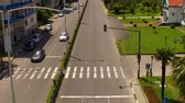 prawo jazdy : Cars driving along highway in Batumi, aerial downtown cityscape, traffic rules