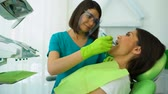pravidelný : Qualified dentist examining woman teeth, regular checkup in modern clinic
