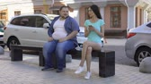 ignorer : Slim woman ignoring overweight man, social rejection, obesity prejudices health