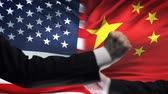 oposicion : US vs China confrontation, countries disagreement, fists on flag background