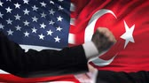 oposicion : US vs Turkey confrontation, countries disagreement, fists on flag background