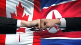 ministers : Canada vs North Korea conflict international relations, fists on flag background Stock Footage