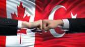 oposicion : Canada vs Turkey conflict, international relations, fists on flag background