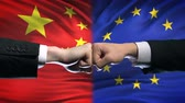 resistenza : China vs EU conflict, international relations crisis, fists on flag background Filmati Stock