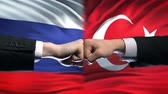 ministers : Russia vs Turkey conflict, international relations, fists on flag background