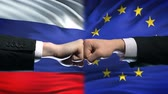 scontro : Russia vs EU conflict, international relations crisis, fists on flag background