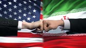 disputa : US vs Iran conflict, international relations crisis, fists on flag background Stock Footage