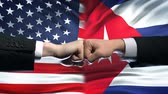 ministers : US vs Cuba conflict, international relations crisis, fists on flag background Stock Footage