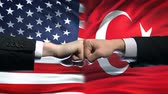 resistenza : US vs Turkey conflict, international relations crisis, fists on flag background