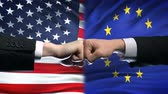 enemy : US vs European Union conflict, international relations, fists on flag background Stock Footage