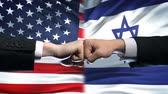 enemy : US vs Israel conflict, international relations crisis, fists on flag background
