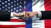 enemy : US vs France conflict, international relations crisis, fists on flag background Stock Footage