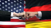 ministers : US vs Germany conflict, international relations crisis, fists on flag background