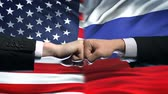 resistenza : US vs Russia conflict, international relations crisis, fists on flag background Filmati Stock