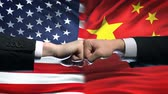 ministers : US vs China conflict, international relations crisis, fists on flag background