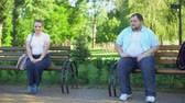overcome : Obese people acquainting modestly, looking playful, flirting at first meeting