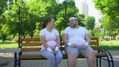 overcome fear : Fat man flirting with obese pretty girl, telling jokes, overcoming insecurities Stock Footage