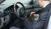 tutturmak : Man wearing seatbelt in car, safety concept, compliance with traffic rules Stok Video