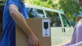 postacı : Irresponsible deliveryman accidently dropping fragile parcel, worker mistake Stok Video