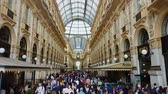 milano : MILAN, ITALY - CIRCA MAY 2018: Shopping in the city. Tourists walking in Galleria Vittorio Emanuele, Milan luxury shopping, fashion