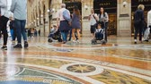 milano : MILAN, ITALY - CIRCA MAY 2018: Shopping in the city. Customers walking in Galleria Vittorio Emanuele Milan, fashion trends, trade