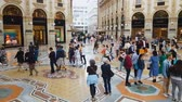 milano : MILAN, ITALY - CIRCA MAY 2018: Shopping in the city. Tourists shopping in famous Milan city mall, Italian architecture, sightseeing