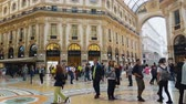 milano : MILAN, ITALY - CIRCA MAY 2018: Shopping in the city. Famous shopping center in Milan, customers walking around, luxury boutiques.