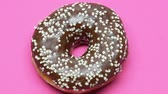 糖尿病 : Chocolate donut on spinning background, food industry, unhealthy eating closeup
