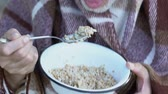 hospice : Weak senior man wrapped in blanket eating porridge, homeless shelter, close-up Stock Footage