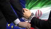 acorrentado : European Union sanctions Iran, chained arms, political or economic conflict.