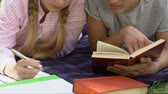 глупый : Teen couple studying bored with homework, difficult education program.